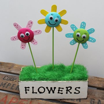 Lolly stick and button form flowers